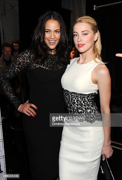 Actresses Paula Patton and Amber Heard pose backstage at the Michael Kors Fall 2012 fashion show during MercedesBenz Fashion Week at The Theatre at...