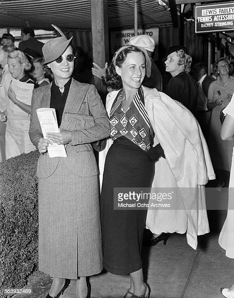 Actresses Paulette Goddard and Mary Astor attend a tennis event Los Angeles California