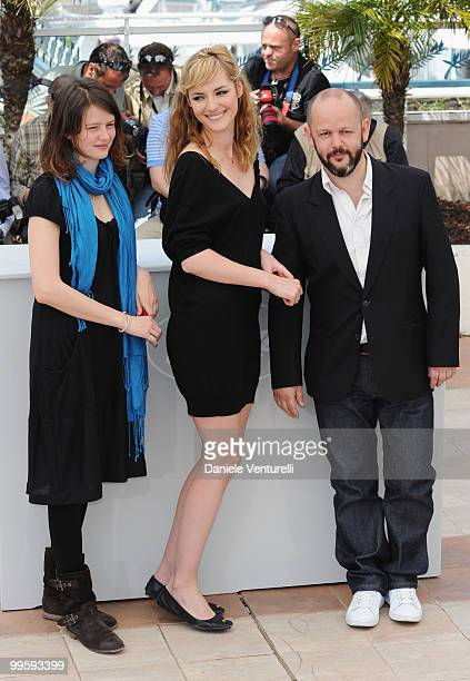 Actresses Pauline Etienne, Louise Bourgoin and Director Gilles Marchand attend the 'Black Heaven' Photo Call held at the Palais des Festivals during...