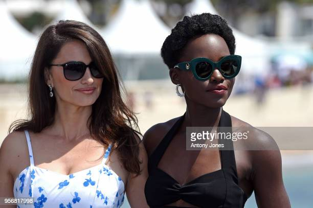 Actresses Penelope Cruz and Lupita Nyong'o attend the photocall for '355' during the 71st annual Cannes Film Festival at Majestic Beach Pier on May...