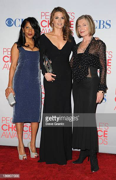 Actresses Penny Johnson Stana Katic and Susan Sullivan pose in the press room during the People's Choice Awards 2012 at Nokia Theatre LA Live on...