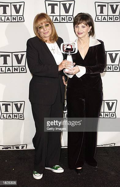 Actresses Penny Marshall and Cindy Williams pose backstage with their Working Stiff of the Year award for Laverne Shirley during the TV Land Awards...