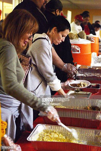 Actresses Penny Marshall and Lori Petty serve food at A Place Called Home which provides atrisk youth with a secure positive family environment...