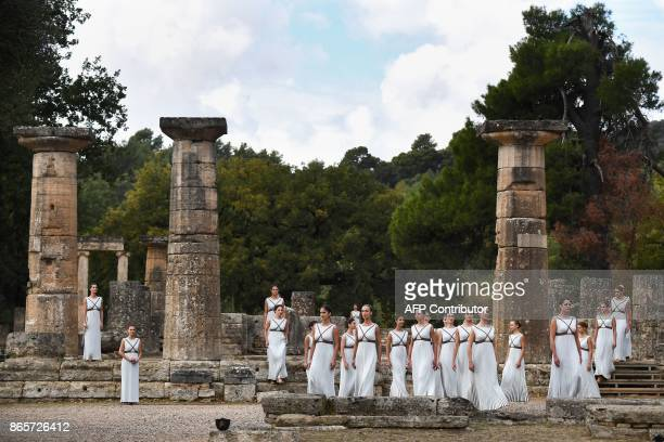 Actresses perform at the Temple of Hera in Olympia the sanctuary where the Olympic Games were born in 776 BC on October 24 2017 during the lighting...