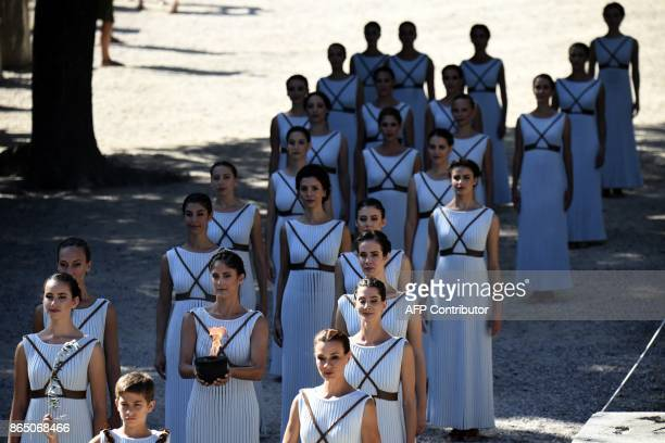 Actresses perform at the Temple of Hera on October 22 2017 during a dressed rehearsal of the lighting ceremony of the Olympic flame in ancient...