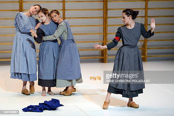 Actresses perform during a rehearsal of the play 'The Four Seasons Restaurant' directed by italian Romeo Castellucci on July 16 2012 in Avignon...