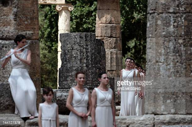 Actresses perform on May 10 2012 during the lighting ceremony in ancient Olympia the sanctuary where the Olympic Games were born in 776 BC The...