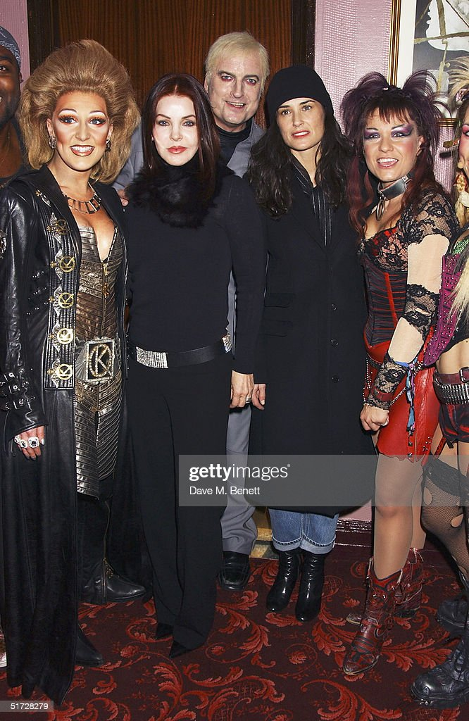Actresses Priscilla Presley, Demi Moore and cast members backstage after seeing 'We Will Rock You', the Queen musical at the Dominion Theatre on November 10, 2004 in London. Demi Moore is in London filming with her daughters and Priscilla Presley is in London to receive the UK Rock 'n' Roll Hall of Fame for her ex-husband Elvis. (Photo by Dave Benett/Getty Images).