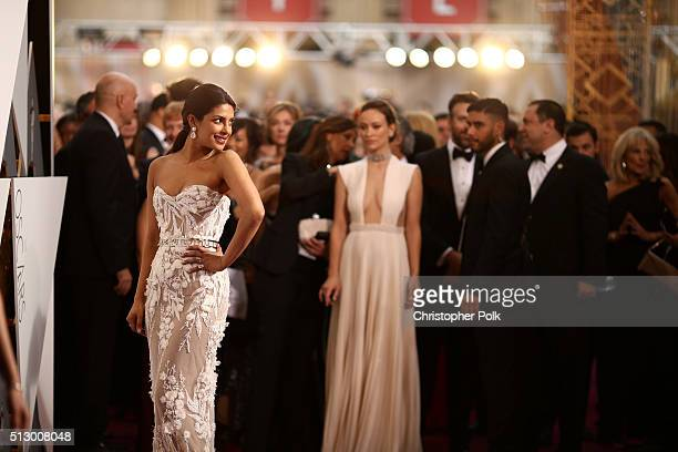 Actresses Priyanka Chopra and Olivia Wilde attend the 88th Annual Academy Awards at Hollywood Highland Center on February 28 2016 in Hollywood...