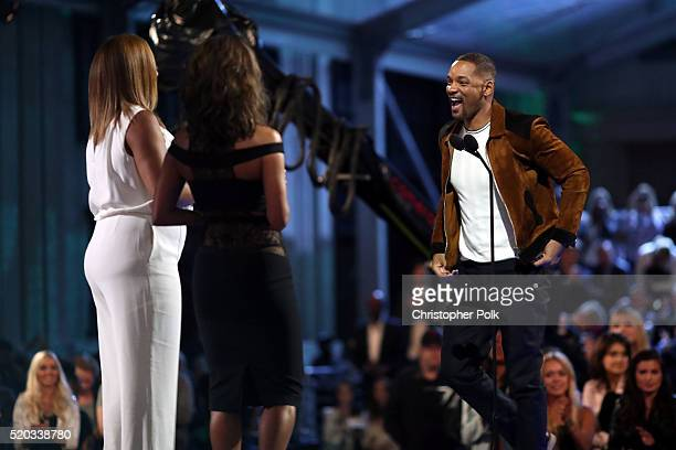 Actresses Queen Latifah and Halle Berry present honoree Will Smith with the Generation Award onstage during the 2016 MTV Movie Awards at Warner Bros...