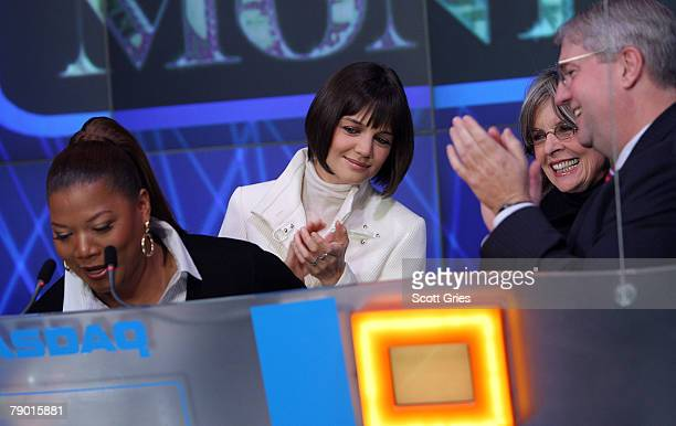 Actresses Queen Latifah Katie Holmes Diane Keaton and NASDAQ Executive Vice president John Jacobs ring the NASDAQ stock market opening bell on...