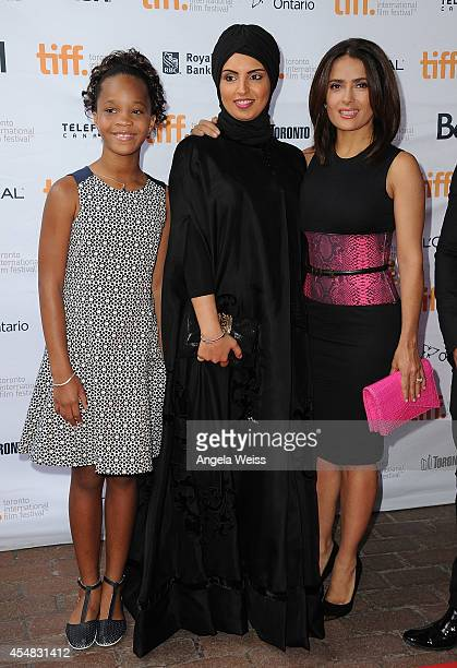 Actresses Quvenzhane Wallis and Salma Hayek with producer Fatma Al Remaihi attend the 'Kahlil Gibran's The Prophet' premiere during the 2014 Toronto...