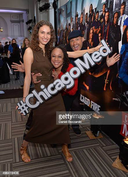 Actresses Rachel DiPillo and S Epatha Merkerson hold a #ChicagoMed hashtag as they attend a press junket for NBC's 'Chicago Fire' 'Chicago PD' and...