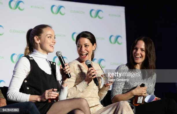 Actresses Rachel Skarsten Emmanuelle Vaugier and Anna Silk speak at the 'Lost Girl Reunion' panel during the ClexaCon 2018 convention at the...