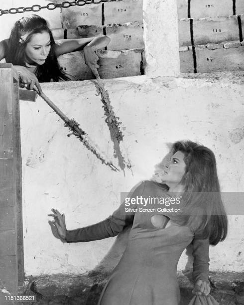Actresses Raquel Welch as Fathom Harvill and Greta Chi as JoMay Soon in the spy film 'Fathom' 1967 Chi is wielding a pair of bullfighting banderillas