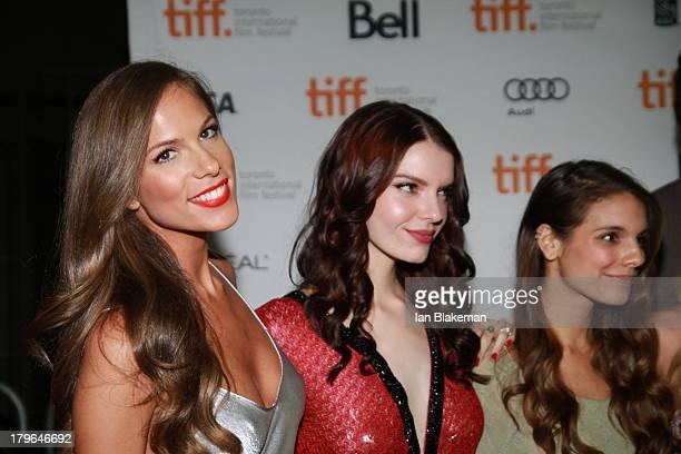 Actresses Reanin Johannink Caitlin Stasey Sianoa SmitMcPhee arrive at Ryerson Theatre on September 5 2013 in Toronto Canada
