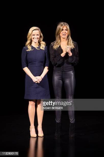Actresses Reese Witherspoon and Jennifer Aniston speak during an event launching Apple tv at Apple headquarters on March 25 in Cupertino California