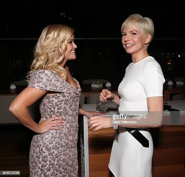 Actresses Reese Witherspoon and Michelle Williams attend the Vanity Fair and Tiffany Co private dinner toasting Lupita Nyong'o and celebrating...