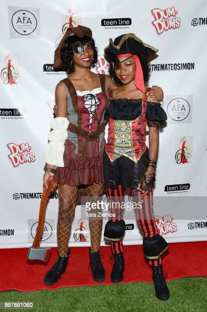 Actresses Riele Downs and Reiya Downs attend Mateo Simon's Halloween Charity Event on October 28 2017 in Burbank California