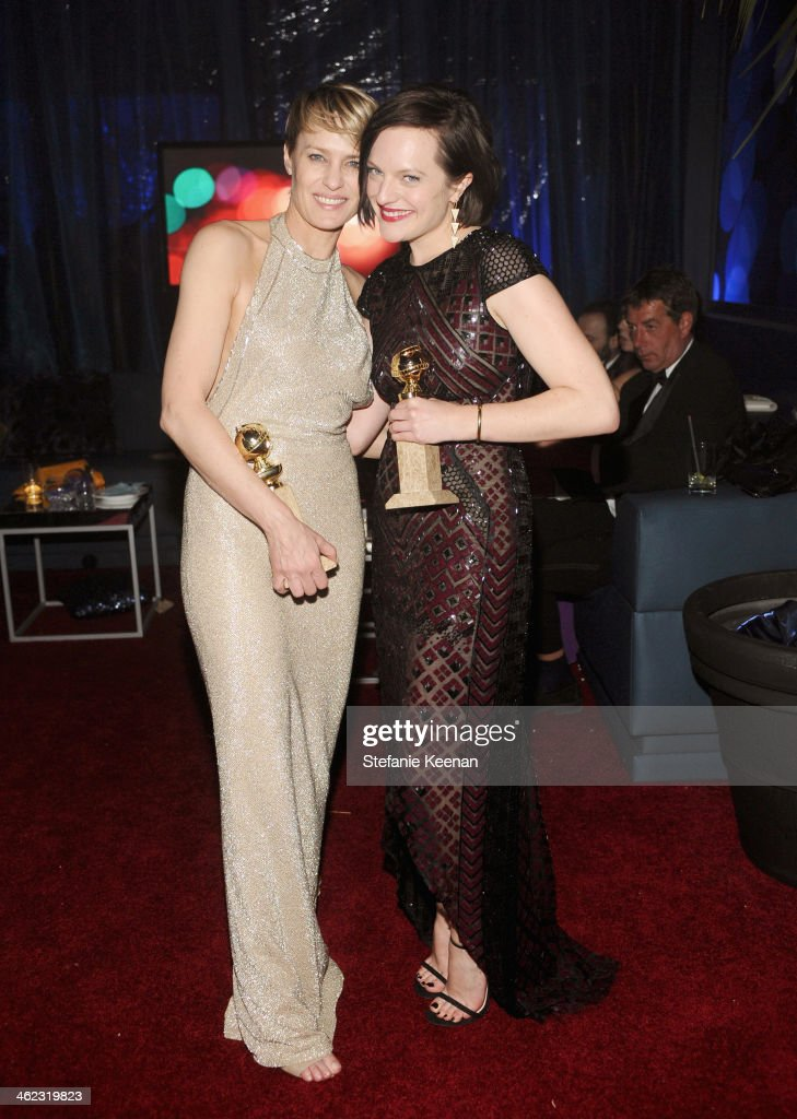 Actresses Robin Wright and Elisabeth Moss attend the 2014 InStyle And Warner Bros. 71st Annual Golden Globe Awards Post-Party at The Beverly Hilton Hotel on January 12, 2014 in Beverly Hills, California.