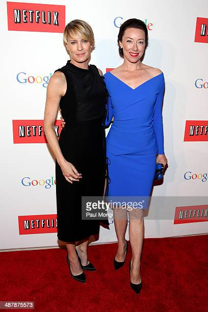 Actresses Robin Wright and Molly Parker walk the red carpet at Google/Netflix White House Correspondent's Weekend Party at United States Institute of...