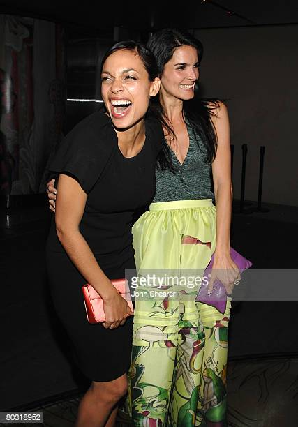 Actresses Rosario Dawson wearing Prada and Angie Harmon wearing Prada attend the Los Angeles screening of Trembled Blossoms presented by Prada on...
