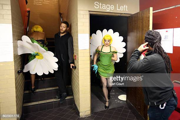 Actresses rush backstage to get changed during a performance of Jack and the Beanstalk at Hackney Empire on December 22 2015 in London England The...