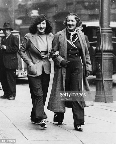 Actresses Ruth Etting and Lupe Velez stars of the play 'Transatlantic Rhythm' walking arm in arm through the streets England September 19th 1936