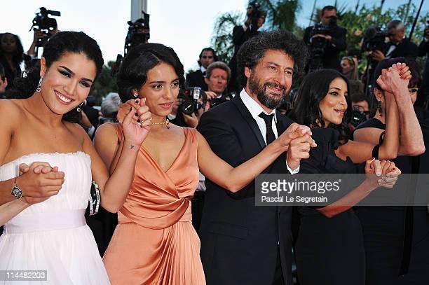 Actresses Sabrina Ouazani Hafsia Herzi director Radu Mihaileanu and Leila Bekhti attend the 'La Source Des Femmes' Premiere at Palais des Festivals...
