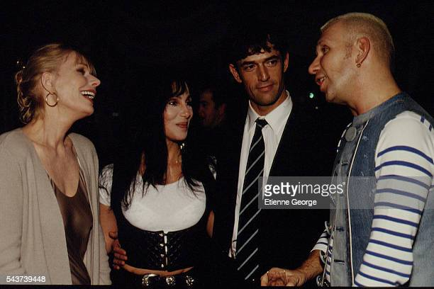 Actresses Sally Kellerman Cher also singer English actor Rupert Everett and French fashion designer JeanPaul Gaultier on the set of the film...