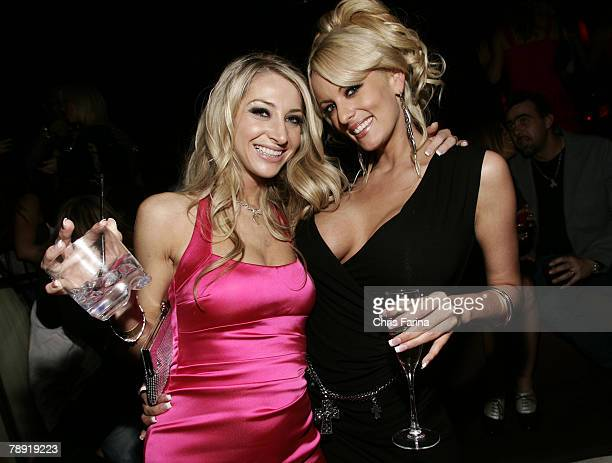 Actresses Sammi Rhodes and Stormy Daniels pose for photos at a naughty night to remember at TAO Nightclub at The Venetian Hotel and Casino Resort on...