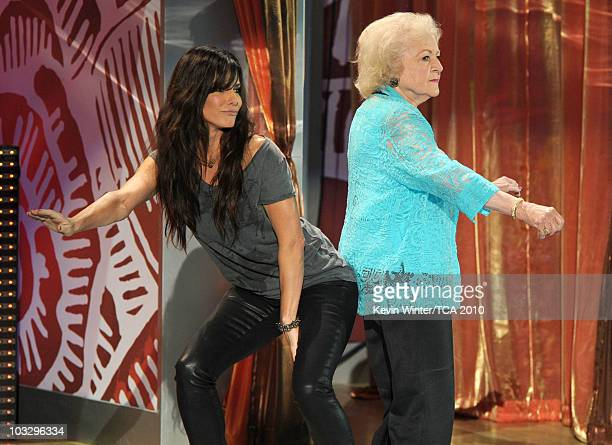 Actresses Sandra Bullock and Betty White speak onstage during the 2010 Teen Choice Awards at Gibson Amphitheatre on August 8, 2010 in Universal City,...