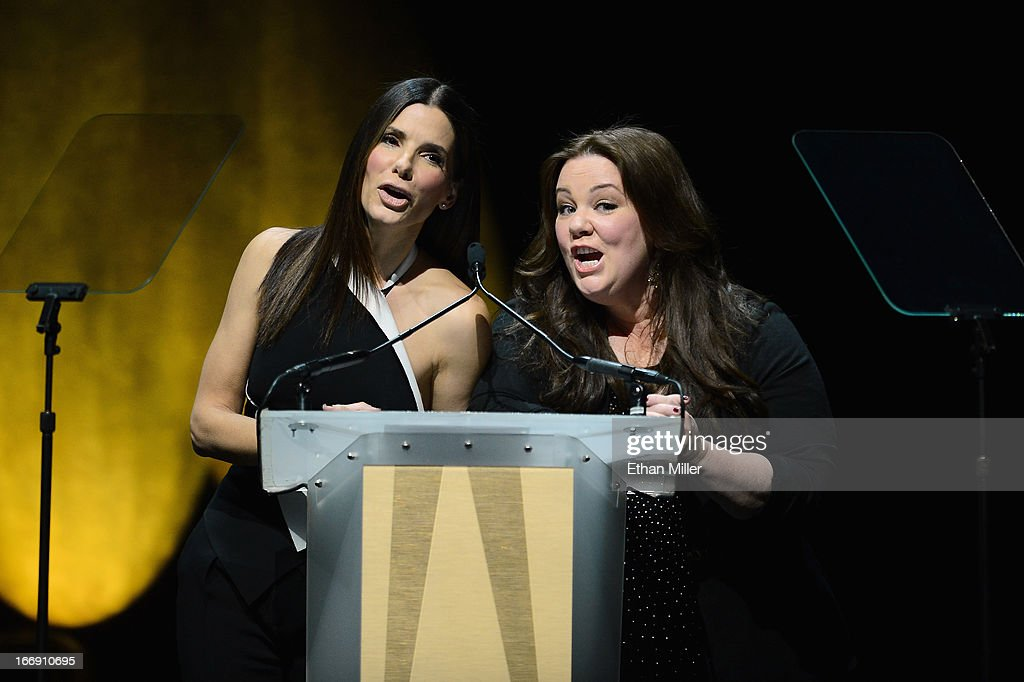 Actresses Sandra Bullock (L) and Melissa McCarthy speak during a Twentieth Century Fox presentation to promote the upcoming film 'The Heat' at The Colosseum at Caesars Palace during CinemaCon, the official convention of the National Association of Theatre Owners, on April 18, 2013 in Las Vegas, Nevada.