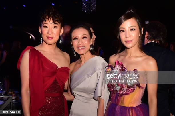 Actresses Sandra Oh Tan Kheng Hua and Fiona Xie attend the 25th Annual Screen Actors Guild Awards show at the Shrine Auditorium in Los Angeles on...