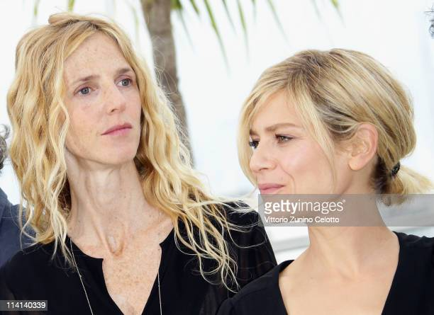 Actresses Sandrine Kiberlain and Marina Fois attends the Polisse photocall at the Palais Des Festivals during the 64th Cannes Film Festival on May 13...