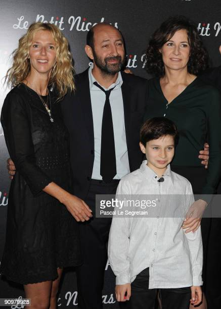 Actresses Sandrine Kiberlain Valerie Lemercier and actor Kad Merad attend the Premiere of Le Petit Nicolas film at Le Grand Rex on September 20 2009...