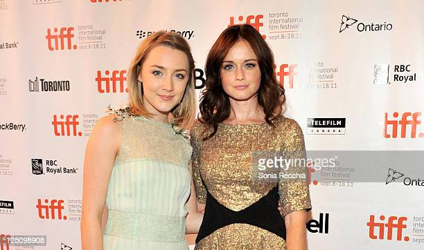 Actresses Saoirse Ronan and Alexis Bledel arrive at Violet Daisy Premiere during the 2011 Toronto International Film Festival held at The Elgin...