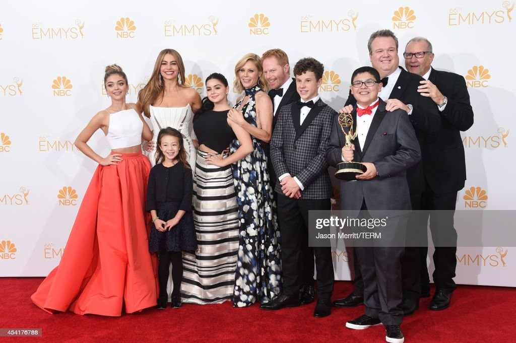 Actresses Sarah Hyland, Sofía Vergara, Aubrey Anderson-Emmons, Julie Bowen and Ariel Winter, Jesse Tyler Ferguson, Nolan Gould, Rico Rodriguez, Eric Stonestreet and Ed O'Neill, winners of the Outstanding Comedy Series Award for 'Modern Family' pose in the press room during the 66th Annual Primetime Emmy Awards held at Nokia Theatre L.A. Live on August 25, 2014 in Los Angeles, California.