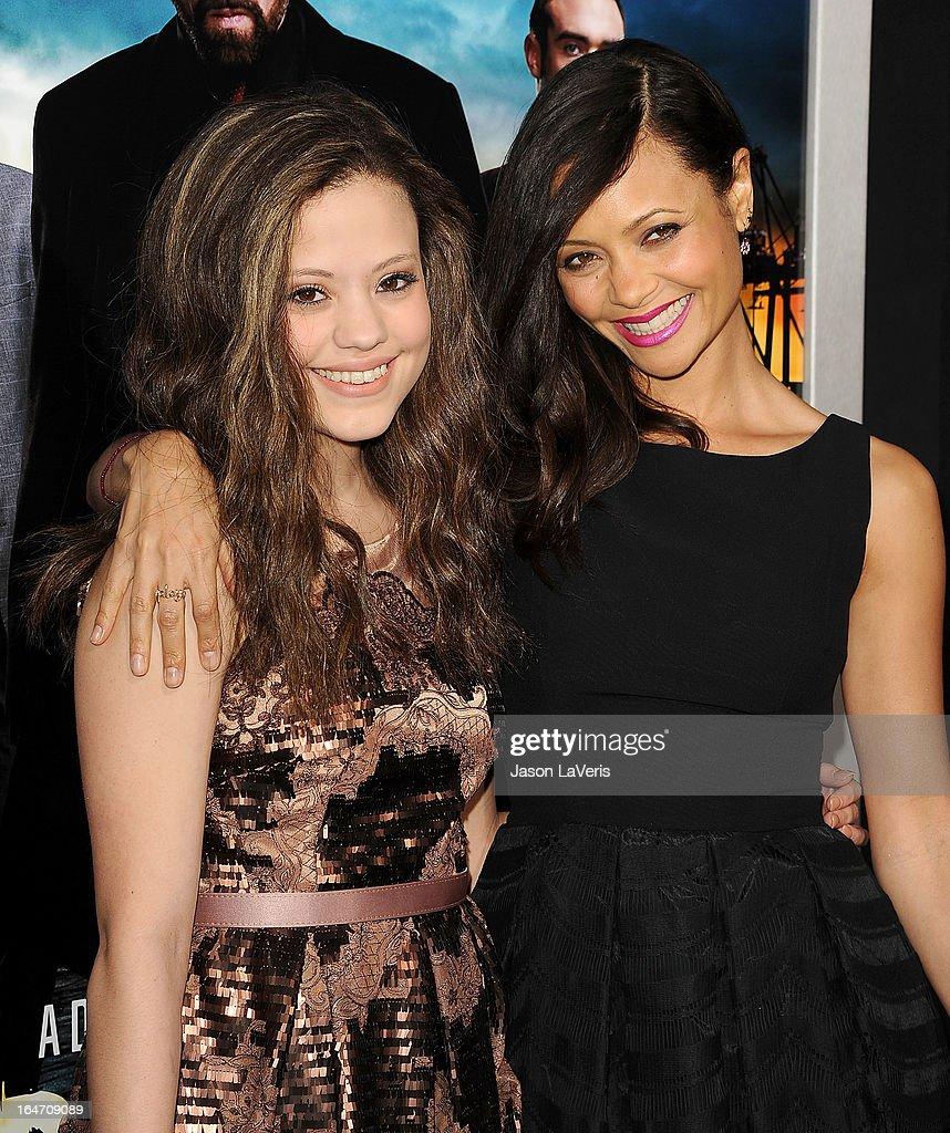 Actresses Sarah Jeffery and Thandie Newton attend the premiere of 'Rogue' at ArcLight Hollywood on March 26, 2013 in Hollywood, California.