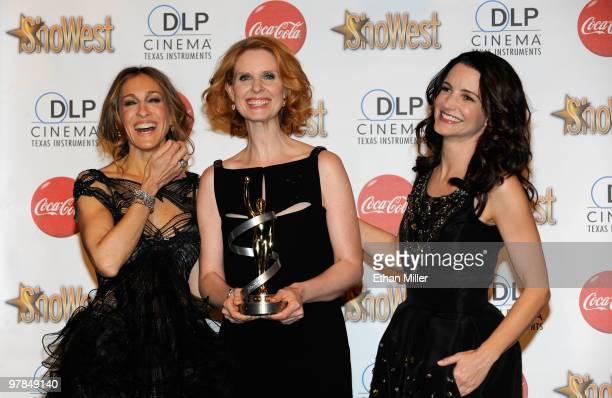 Actresses Sarah Jessica Parker Cynthia Nixon and Kristin Davis recipients of the Ensemble Award arrive at the ShoWest awards ceremony at the Paris...