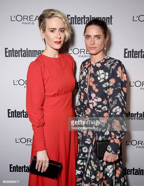 Actresses Sarah Paulson and Amanda Peet attend the 2016 Entertainment Weekly PreEmmy party at Nightingale Plaza on September 16 2016 in Los Angeles...