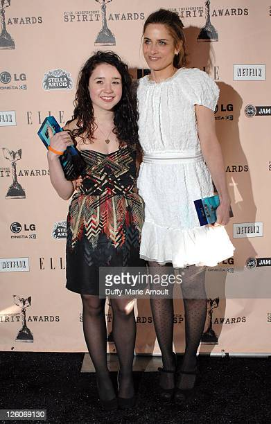 Actresses Sarah Steele and Amanda Peet pose in the press room during the 2011 Film Independent Spirit Awards at Santa Monica Beach on February 26...