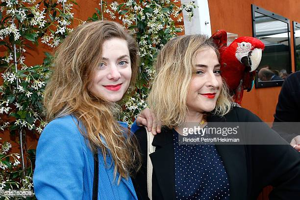 Actresses Sarah Suco and Marilou Berry pose with parrot Arthur during Day Height of the 2016 French Tennis Open at Roland Garros on May 29 2016 in...