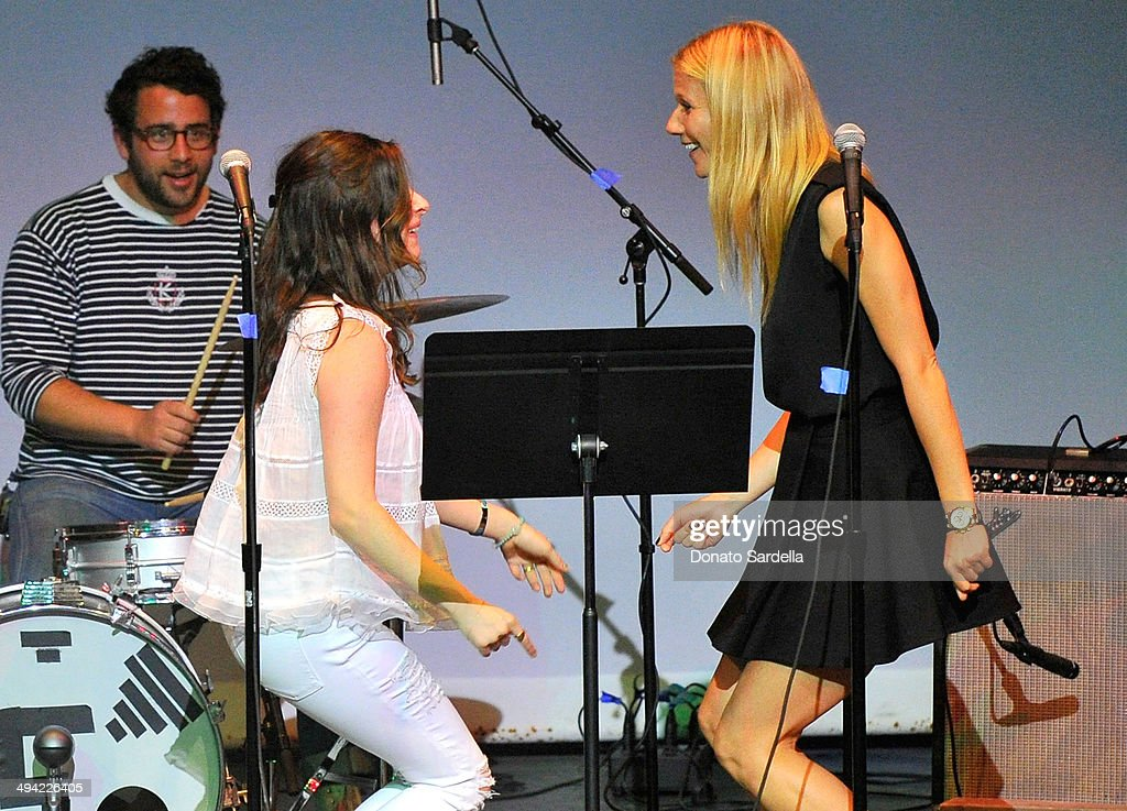 Actresses Sasha Spielberg (L) and Gwyneth Paltrow perform onstage at the first annual Poetic Justice Fundraiser for the Coalition For Engaged Education at the Herb Alpert Educational Village on May 28, 2014 in Santa Monica, California.