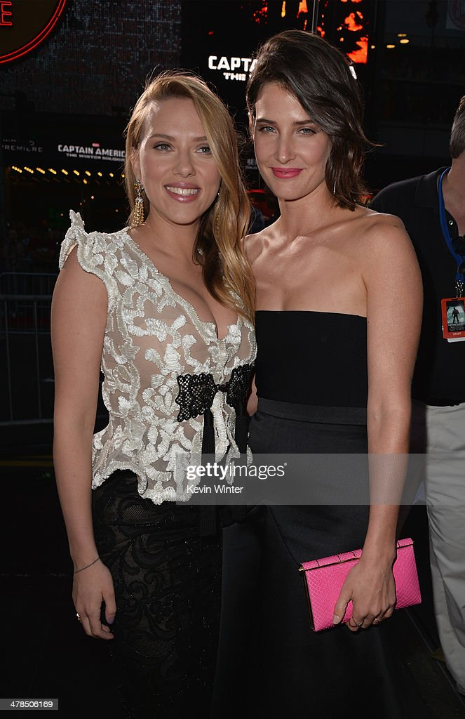 Actresses Scarlett Johansson and Cobie Smulders attend the premiere of Marvel's 'Captain America: The Winter Soldier' at the El Capitan Theatre on March 13, 2014 in Hollywood, California.
