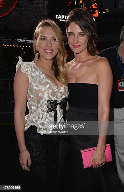 Actresses Scarlett Johansson and Cobie Smulders attend the premiere of Marvel's 'Captain America The Winter Soldier' at the El Capitan Theatre on...
