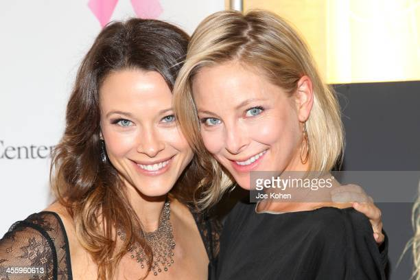 Actresses Scottie Thompson and Anastasia Griffith attend TJ Scott's 'In The Tub' book launch party at Light in Art on December 12 2013 in Los Angeles...