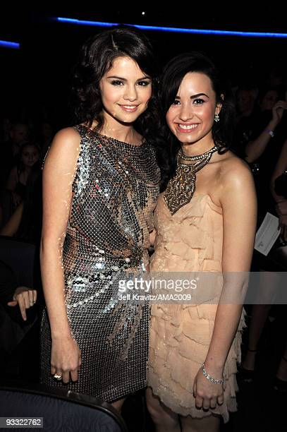 Actresses Selena Gomez and Demi Lovato attend the 2009 American Music Awards at Nokia Theatre LA Live on November 22 2009 in Los Angeles California