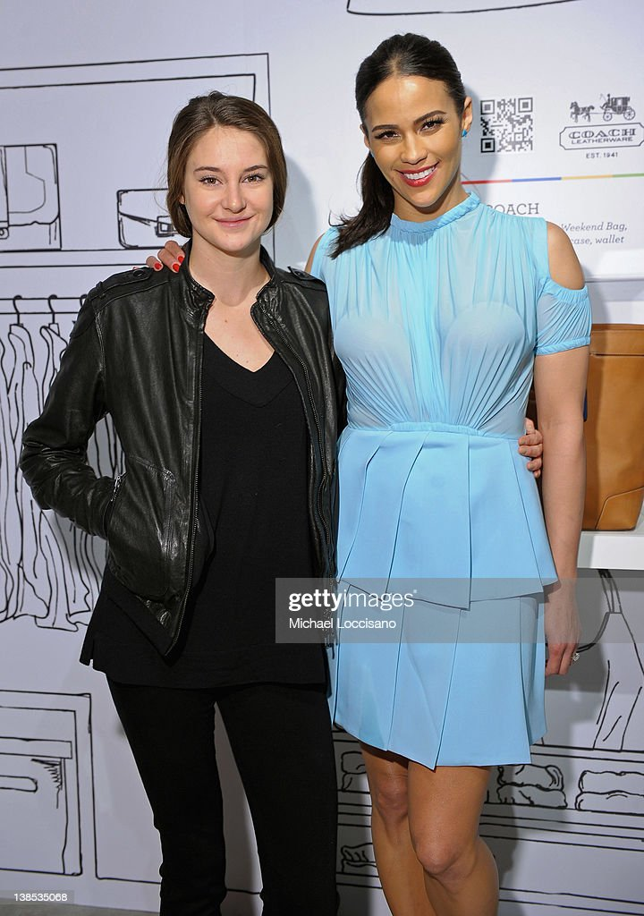 Actresses Shailene Woodley (L) and Paula Patton attend eBay Celebrity and Brad Pitt's Make It Right Celebrate Pop-Up Gallery Exhibition at Chelsea Market on February 8, 2012 in New York City.