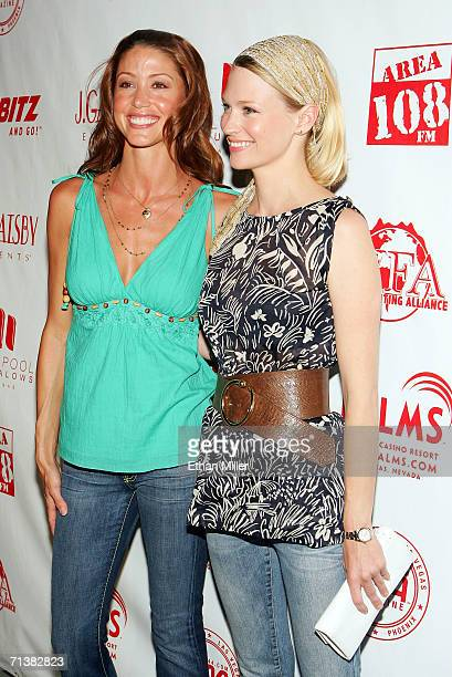 Actresses Shannon Elizabeth and January Jones arrive at a Camp Freddy concert during the unveiling of the USD 40 million pool opening and 944...